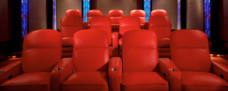 3 rows of Magestic red leather chairs.